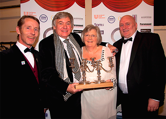 GRA chairman Ryan James, left, and Craig Stevenson of Braehead Foods, right, with Lifetime Achievement Award winners Jim and Gilly Wilson.