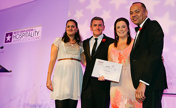 Claire Livingston, right, receives her prize at the Best Employers in Hospitality Awards.