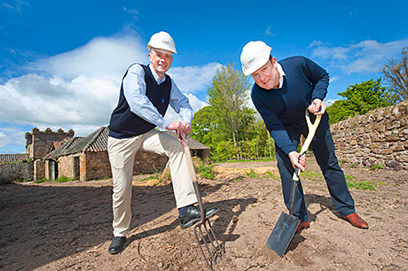 Doug Clement (left) and William Wemyss break ground at the site.