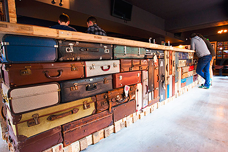 One of the main design features in Pilgrim, the bar frontage is made from old suitcases.