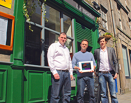 • iPos inventors Robin Knox (left) and Paul Walton (right) with Meadow bar owner Christian White.