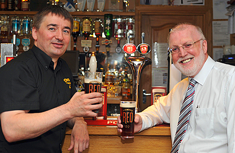 Cheers: Dennis Forsyth and Ken McDade enjoy a pint of McEwan's Red.