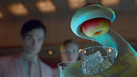 A snake serves up a Smirnoff Apple Bite in the new marketing campaign for the vodka brand.