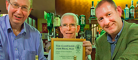 • James Clancy of the Laurieston (centre) receives the award from Glasgow CAMRA's Stan Thompson (left) and Kenny Hannah.