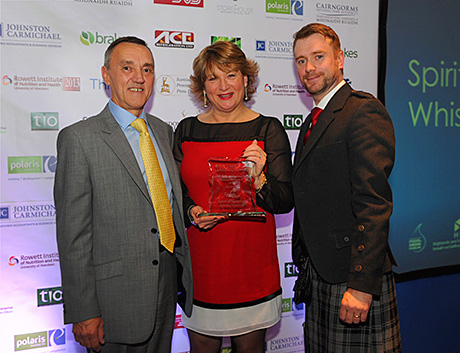 • James Campbell (left) and Mary Hemsworth of the Spirit of Speyside Whisky Festival accept their award.