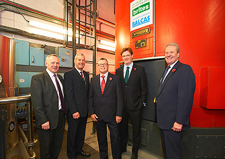 • Tomatin Distillery boss Robert Anderson (centre) explains the economic and environmental benefits of the new boiler.