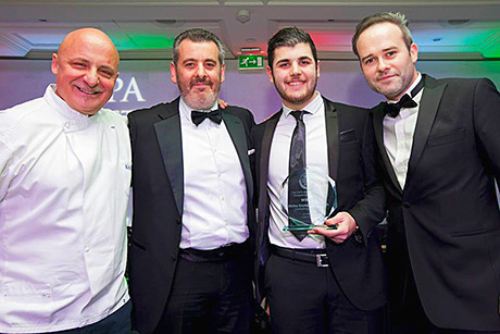 • Vittoria Group's Crolla family accepting an award from chef Aldo Zilli (left).