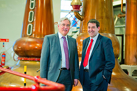 • Ian Macleod Distillers' Mike Younger (right) with Laurence Jamieson.