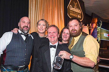 • The Lewis family from Monachyle Mhor collects the Glenfiddich Spirit of Scotland Business Award from Scotsman editor Ian Stewart (centre).