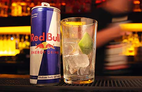 Red Bull suggested serving energy drinks from a cold can into a glass over ice with lime.