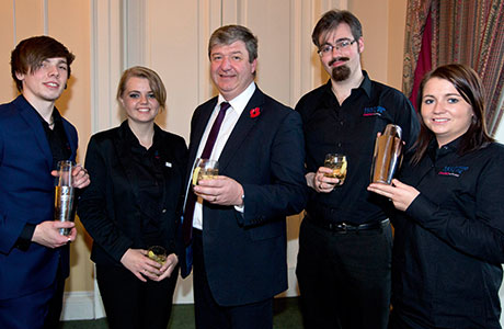 • Secretary of State for Scotland Alistair Carmichael (centre) with Learning for Life Scotland graduates Alastair Stewart, Madaleine Davidson, Michael Gallagher and Jenna Mason.