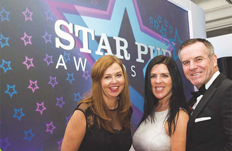 • McCracken with Silvia and Frank Healey at Star Pubs & Bars' awards.