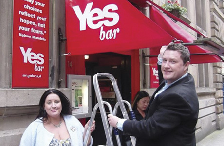 • Owners Jim and Suzanne McLaughlin unveiling the Yes Bar branding.