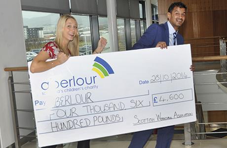 • Sarah Nicholson of Aberlour and SWA president Asim Sarwar with cheque.