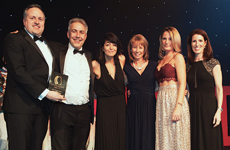 The team collecting the award.
