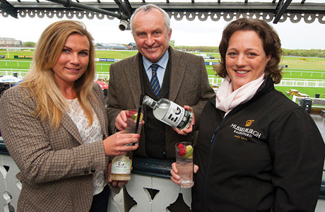 Hattie and Alex Nicol with racecourse manager Sarah Montgomery.