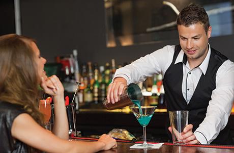 shutterstock_bartender pouring drink