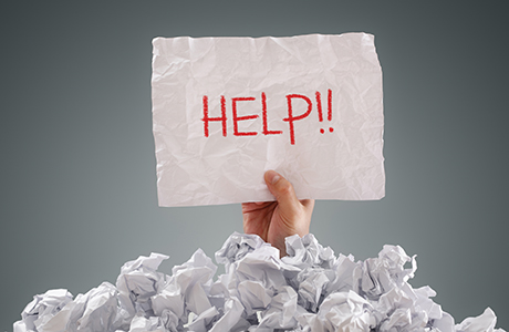 shutterstock_buried in paperwork
