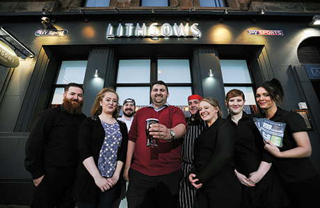 • John Cairns (centre) and his team raise a glass to the rejuvenated Lithgows pub in Greenock. 'Lithgow's pub, Greenock, Scotland.  Pictured left to right are staff  :  Sean Carney, Lorna Watt, David Butler, John Cairns, Richard McEwan, Jennifer Leck, Lauren Somerville, Lisa McAughey.  7/10/15 Picture © Andy Buchanan 2015