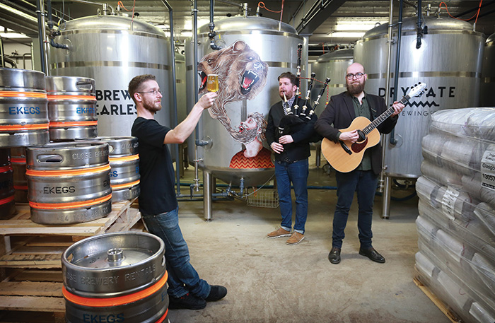 • Musicians John Mulhearn and Finlay Napier played to the brewing team during production. Picture by Stewart Attwood