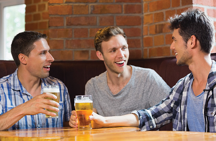 shutterstock_guys drinking pints