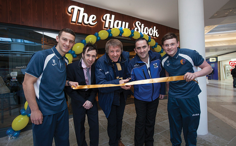 The opening of the Hay Stook. Pic of (lots) East Kilbride FC, Scott Stevenson, Hay Stook manager David McAuley, EK FC manager Billy Olilvie, darts player Ross 'the boss' Montgomery and EK FC's Jacob Kean. Picture by Chris James 23/2/16