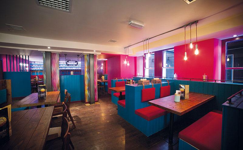 • The interior of the Cuban-themed venue has a bold colour scheme.