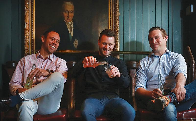 • Òrach creators Dave Millard, David McLauchlan and James Doig toast the new drink.