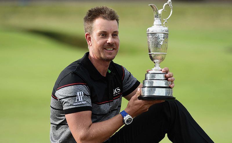 TROON, SCOTLAND - JULY 17: Henrik Stenson of Sweden poses with the Claret Jug following his victory during the final round on day four of the 145th Open Championship at Royal Troon on July 17, 2016 in Troon, Scotland. (Photo by David Cannon/R&A/R&A via Getty Images)