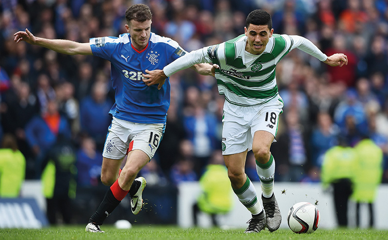 GLASGOW, SCOTLAND - APRIL 17: Andy Halliday of Rangers holds Tomas Rogic of Celtic during the William Hill Scottish Cup semi final between Rangers and Celtic at Hampden Park on April 17, 2016 in Glasgow, Scotland. (Photo by Jeff J Mitchell/Getty Images)