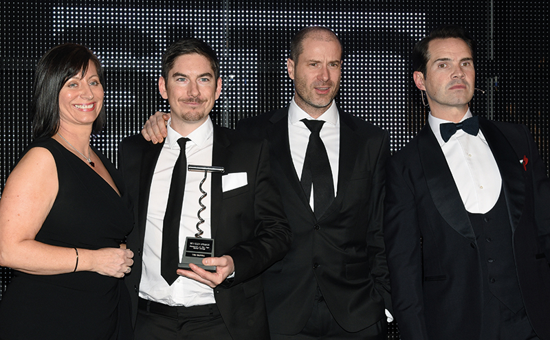 • Peter McKenna (second from left) and Ivan Stein collect their award.