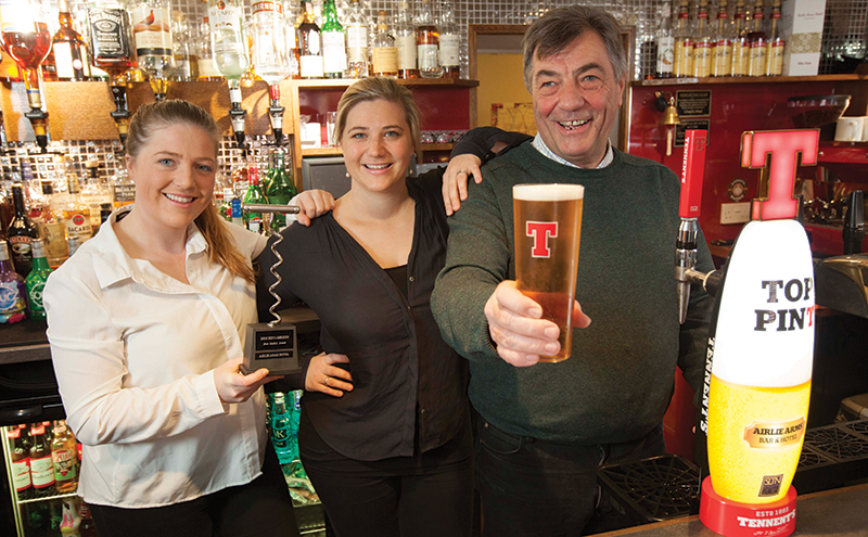 • The Airlie Arms team raises a glass to the special SLTN Awards font.