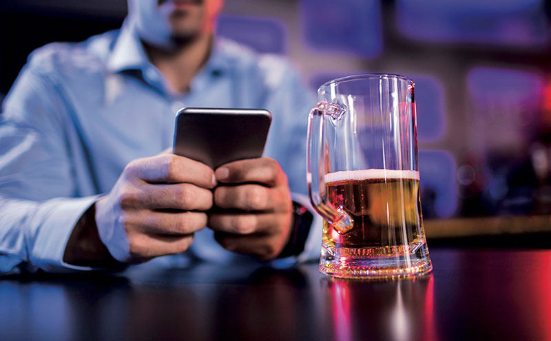 Phone and beer in bar
