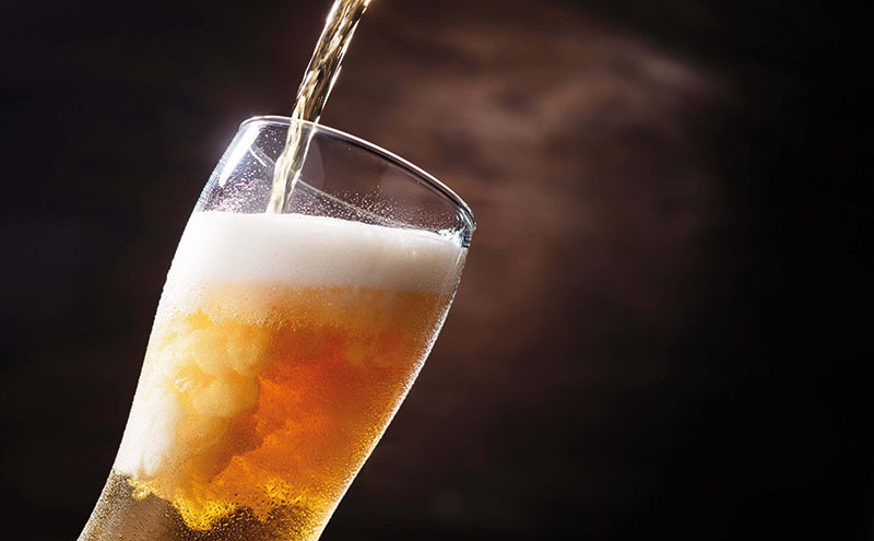 Beer glass being poured