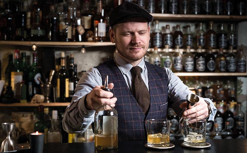 Bartender pouring whisky