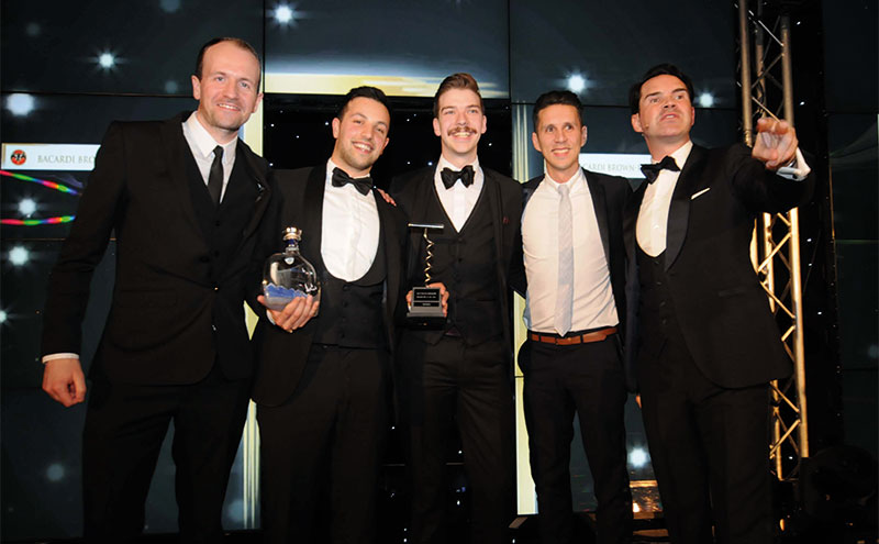 Iravani (second left) and the Orchid team collecting their award