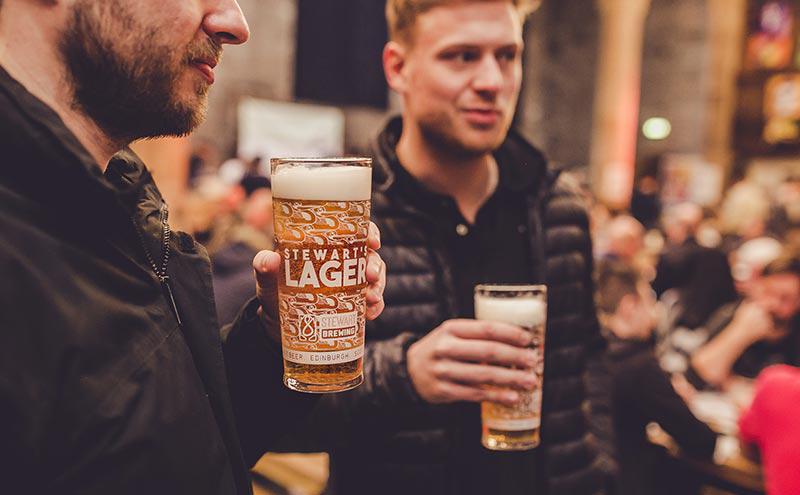 Men drinking pints