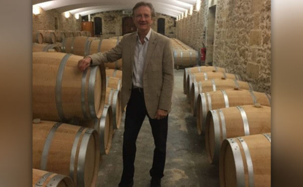 Wine veteran steps down