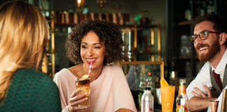 woman-drinking-cocktail-in-bar
