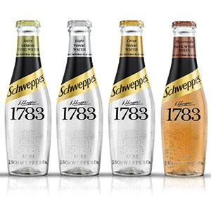 four bottles of Schwepps mixers