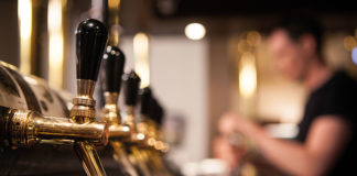 Blurry-bartender-and-beer-taps