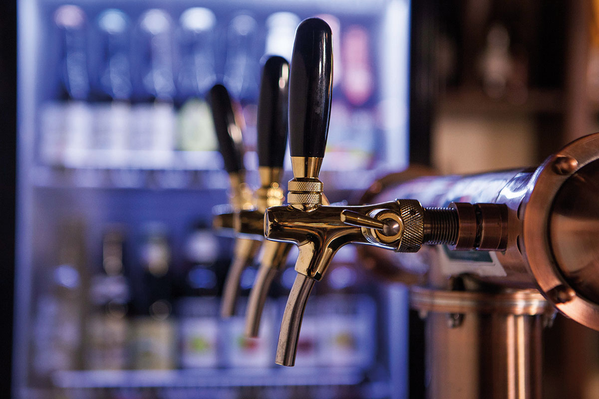 Beer-taps-with-fridge-in-background