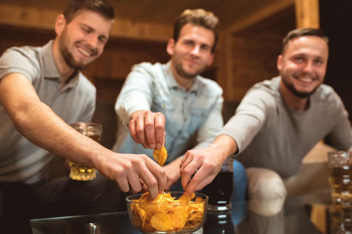 Men eating crisps