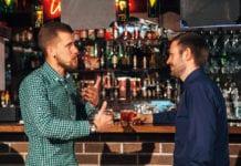Men in bar drinking whisky
