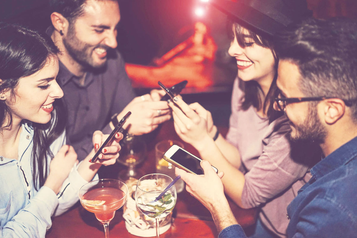 People in pub on phones