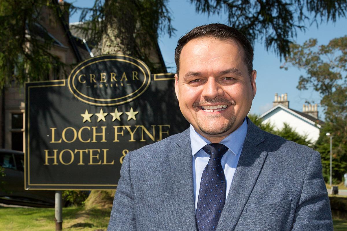 Chris Wayne-Wills outside Loch Fyne Hotel and Spa