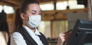 Staff member with face mask